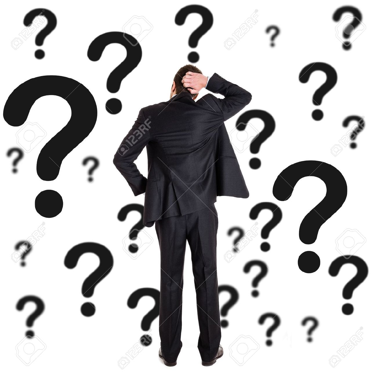 Thoughtful Man Surrounded By Question Marks Stock Photo, Picture And ...