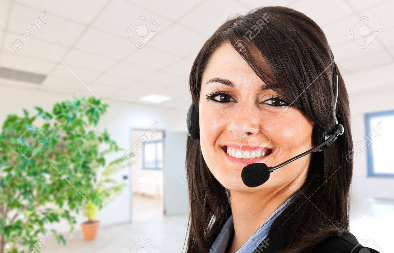 Portrait of a beautiful customer representative in an office environment Stock Photo - 17575403