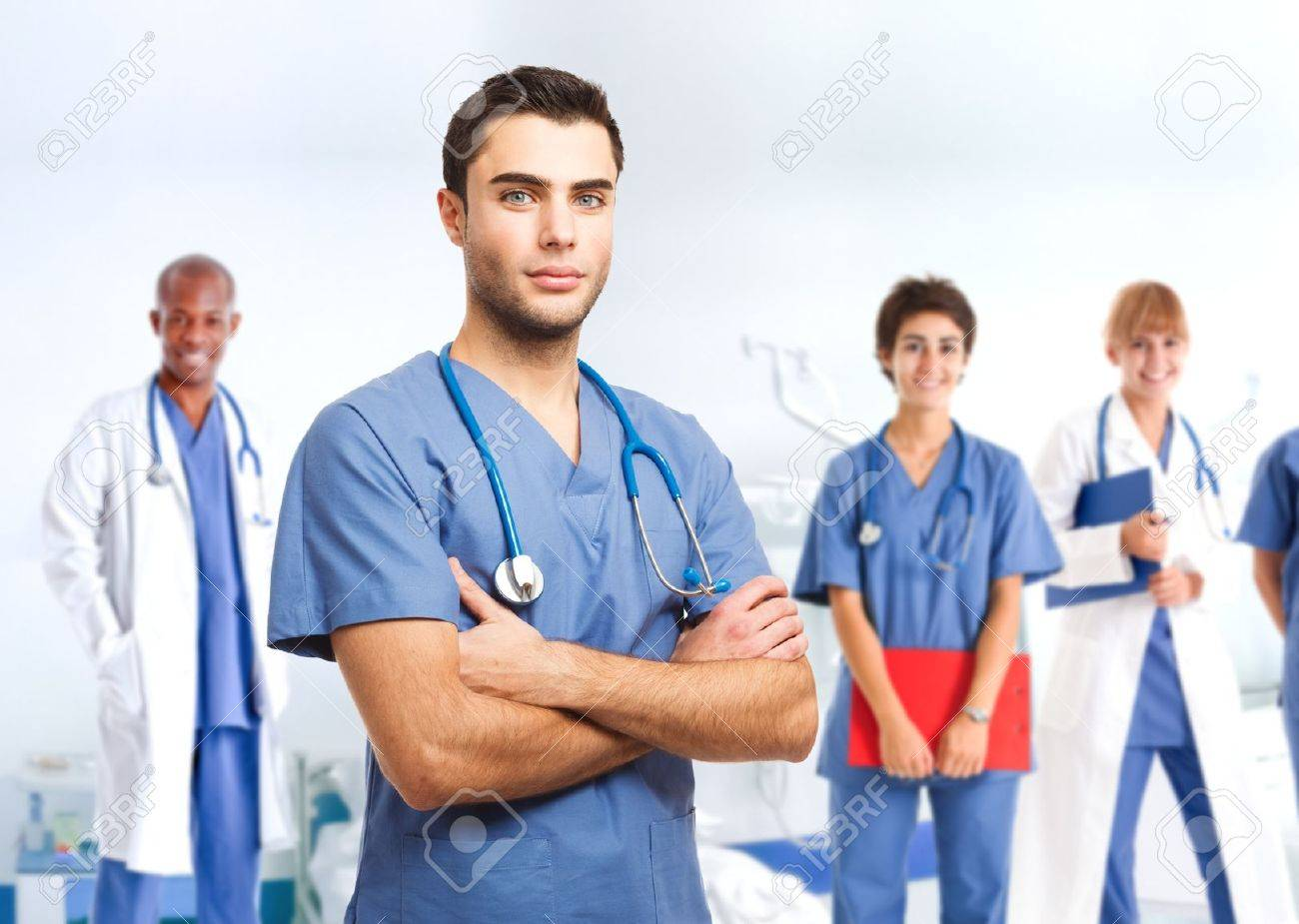 Portrait of an handsome doctor in front of his medical team Stock Photo - 17792264
