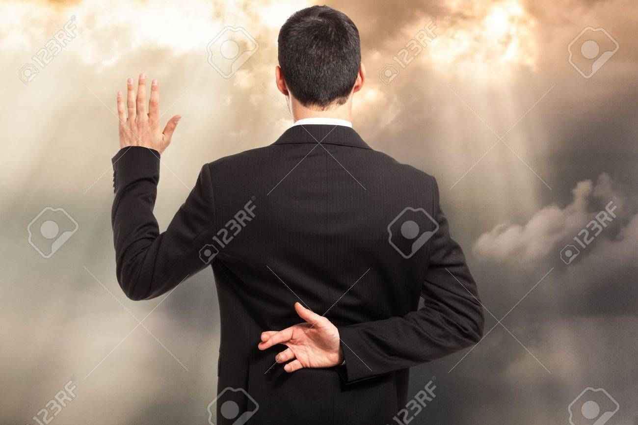 Swearing an oath with fingers crossed behind back Stock Photo - 18466294
