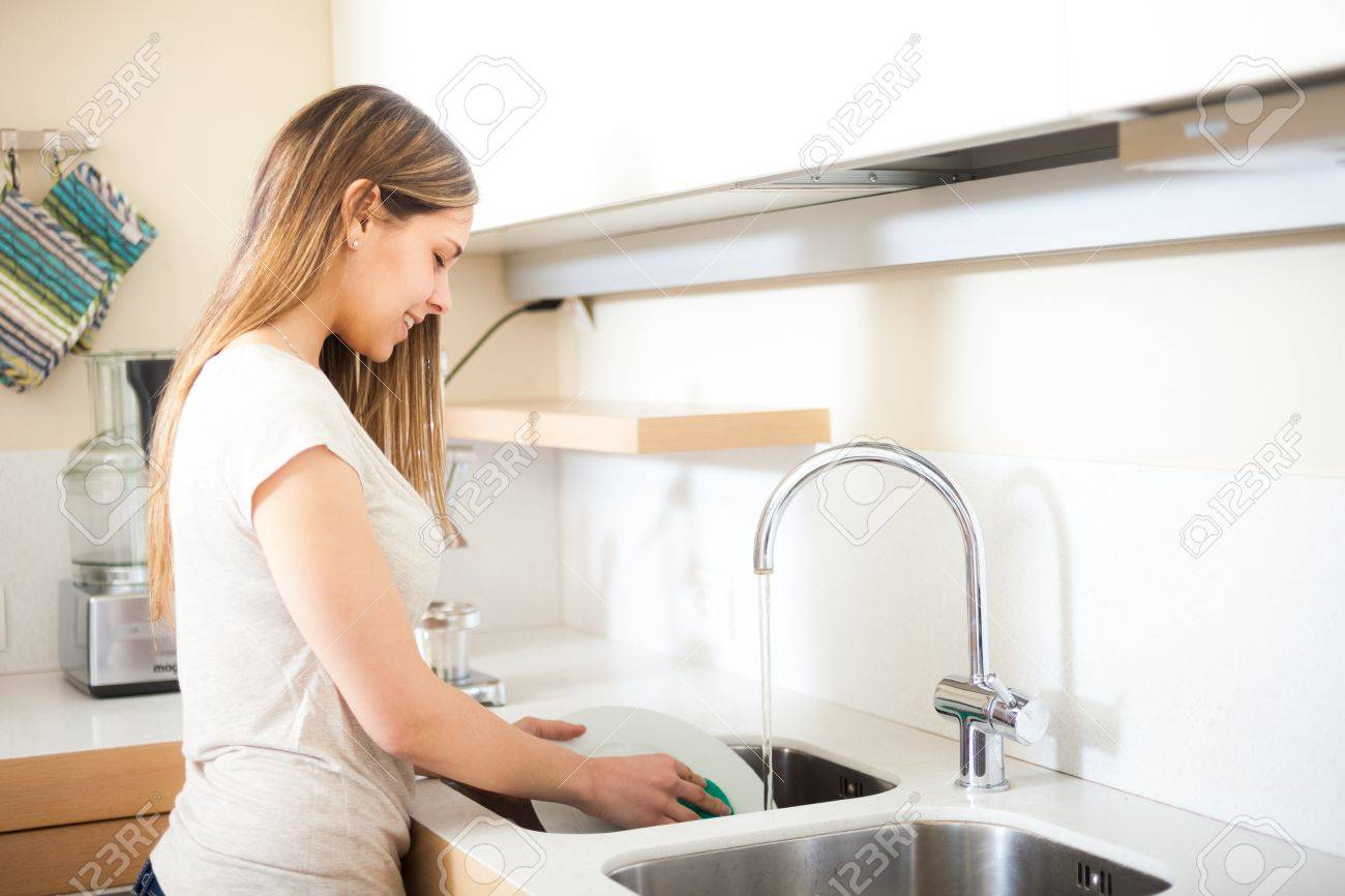 Woman Doing Dishes In Her Kitchen Stock Photo, Picture And Royalty ...
