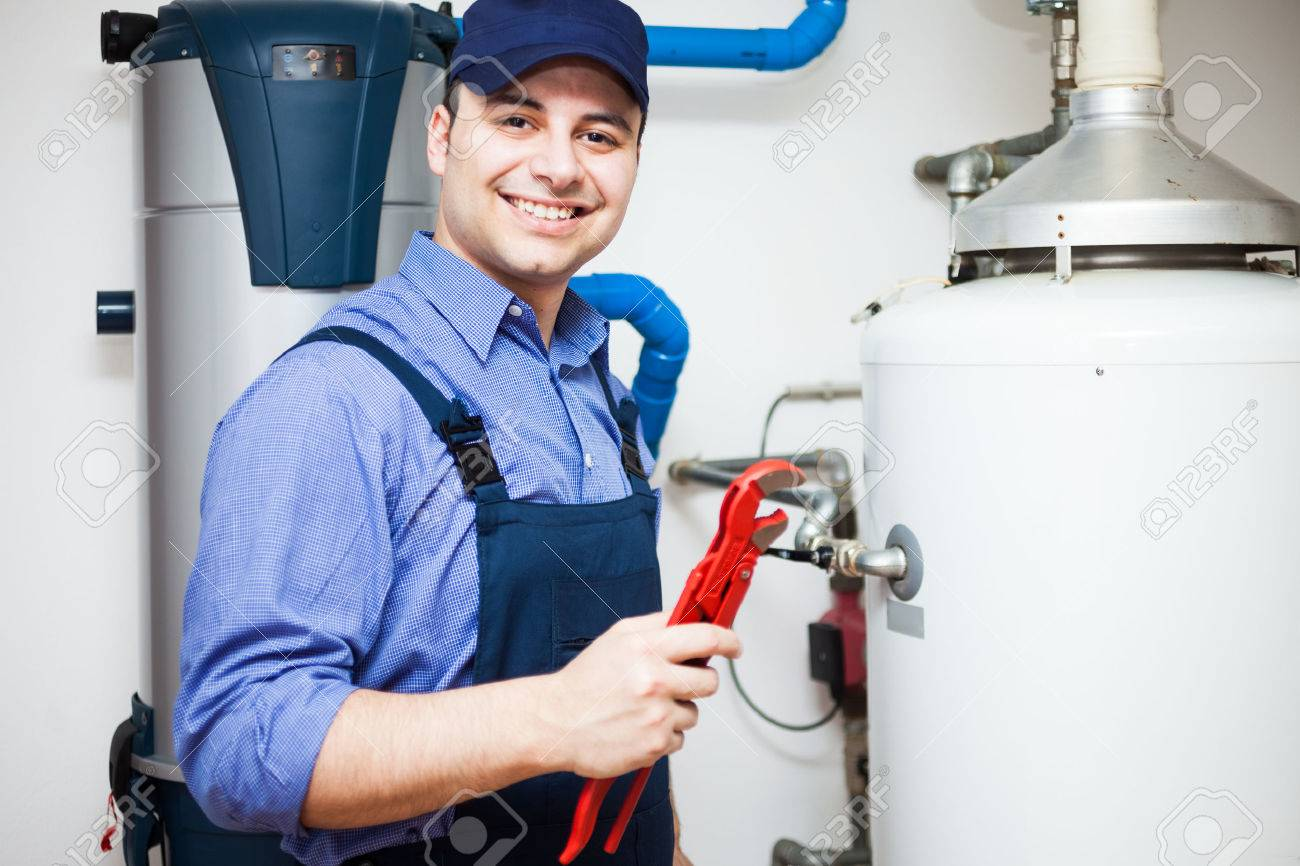 Portrait of a smiling plumber at work - 22770882