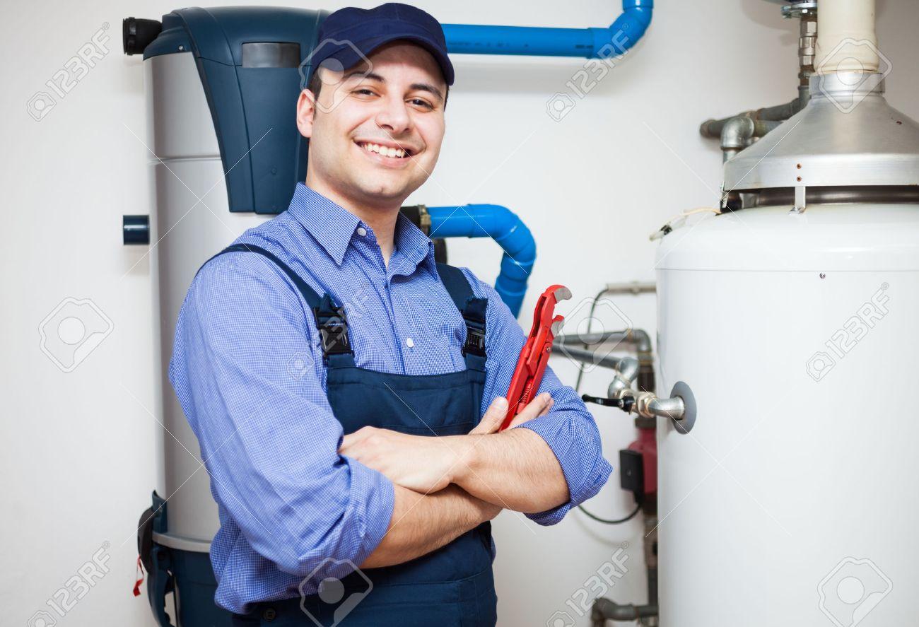 Technician servicing an hot-water heater - 22770883