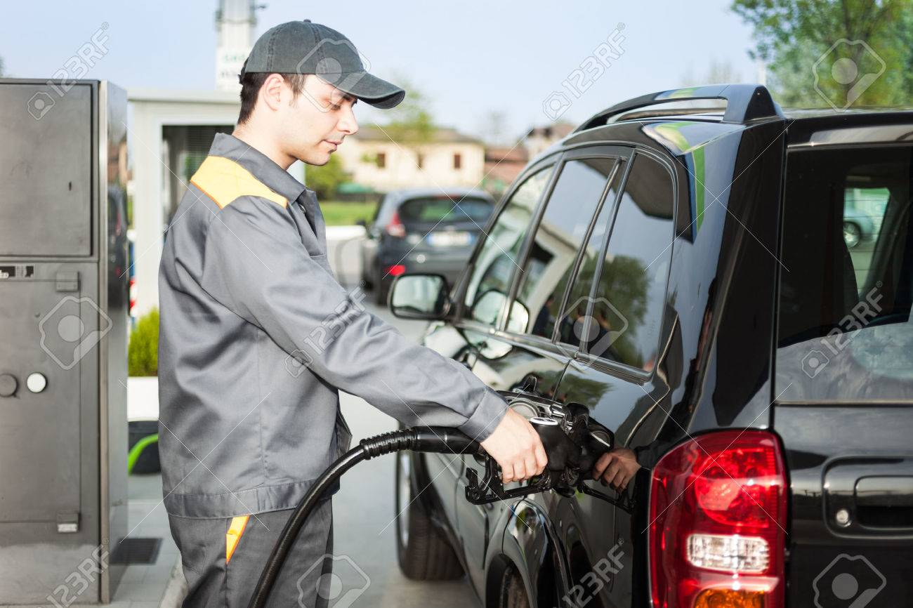 gas station attendant at work stock photo 27647436