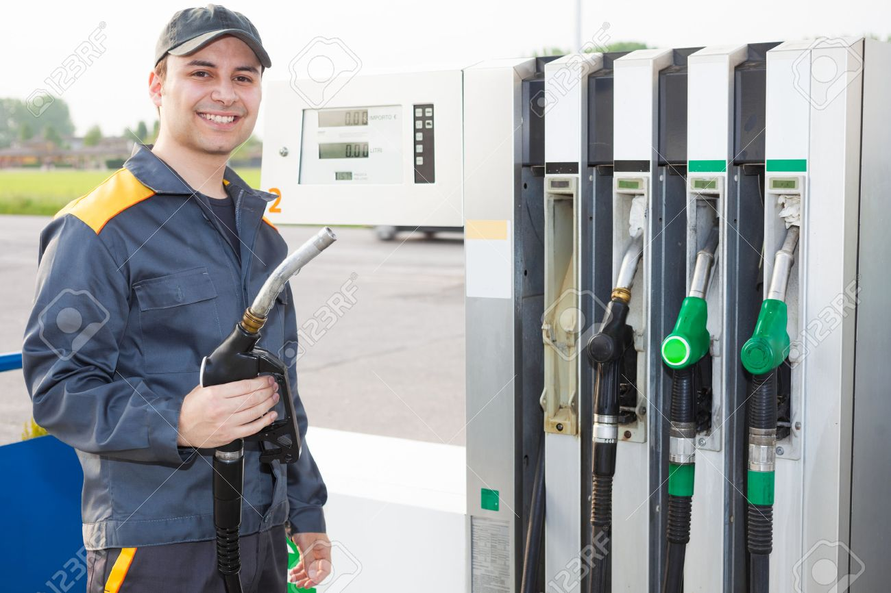 gas station attendant at work stock photo 27647563