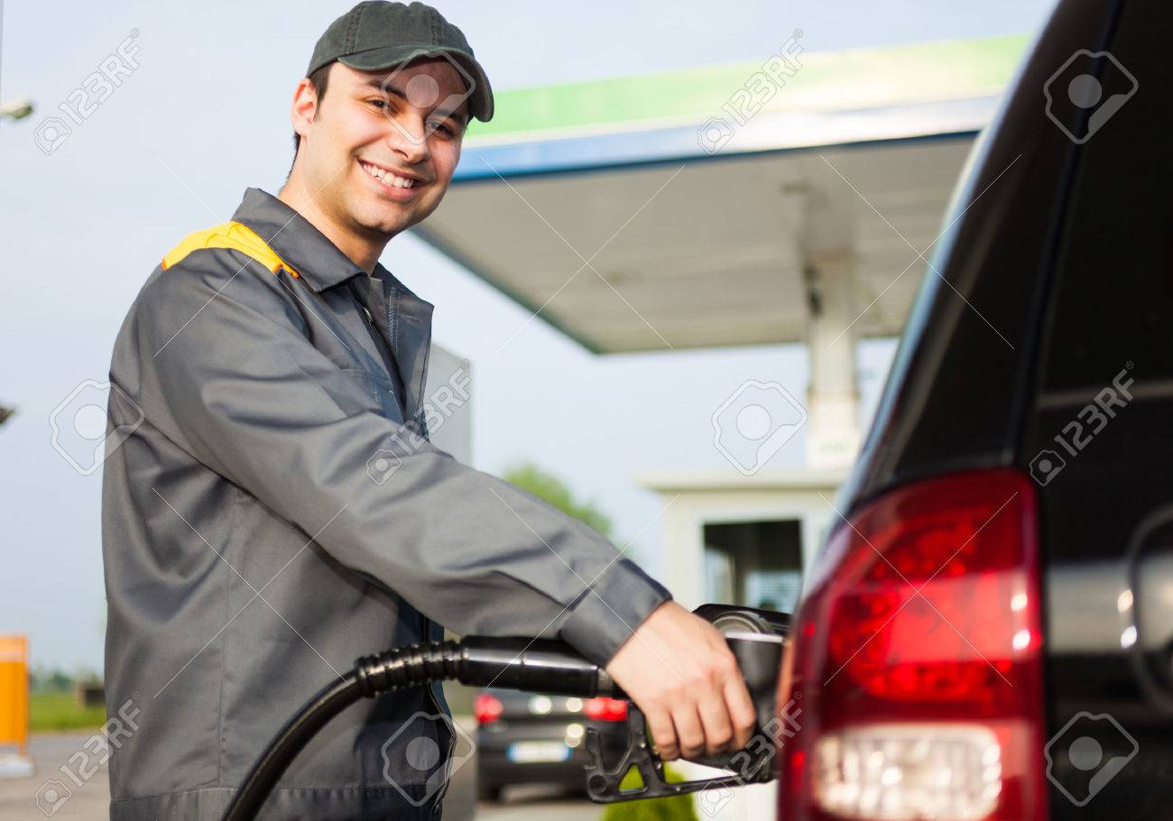 smiling gas station attendant at work stock photo 31042746