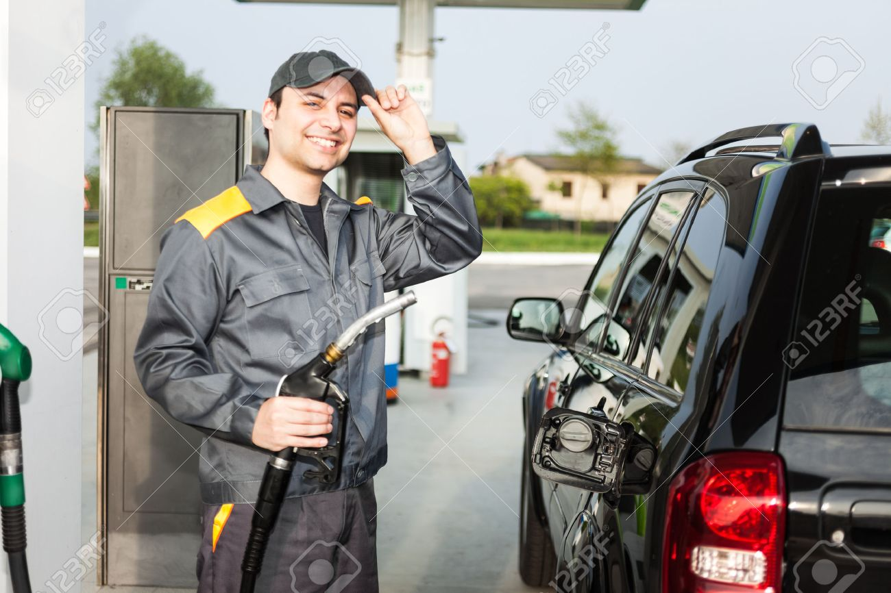 smiling gas station attendant at work stock photo 31042747