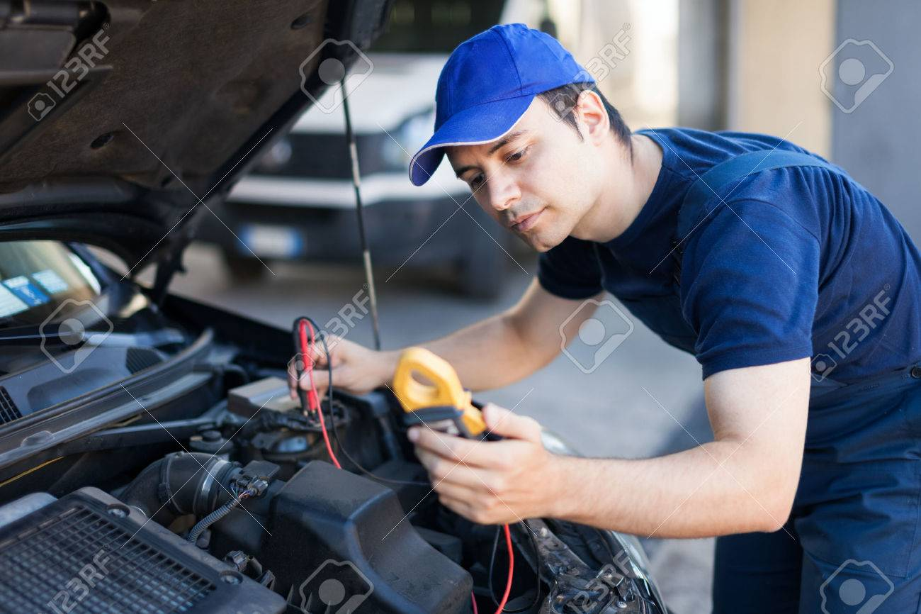 auto electrician troubleshooting a car engine stock photo picture auto electrician troubleshooting a car engine stock photo 31043149