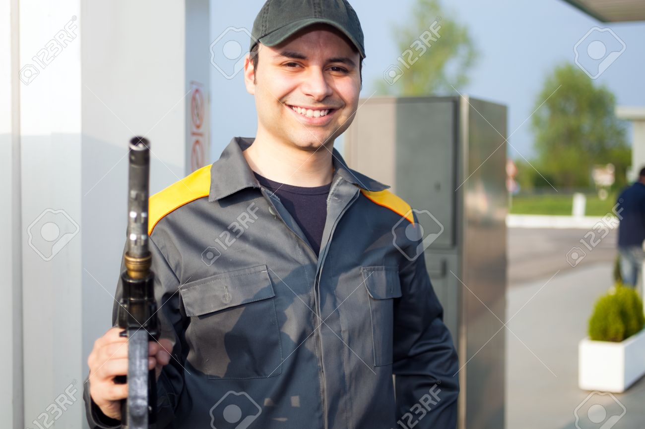 smiling gas station attendant at work stock photo 32258735