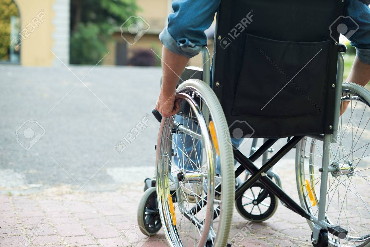 Detail of a disabled man trying to getting on a ramp - 42245767