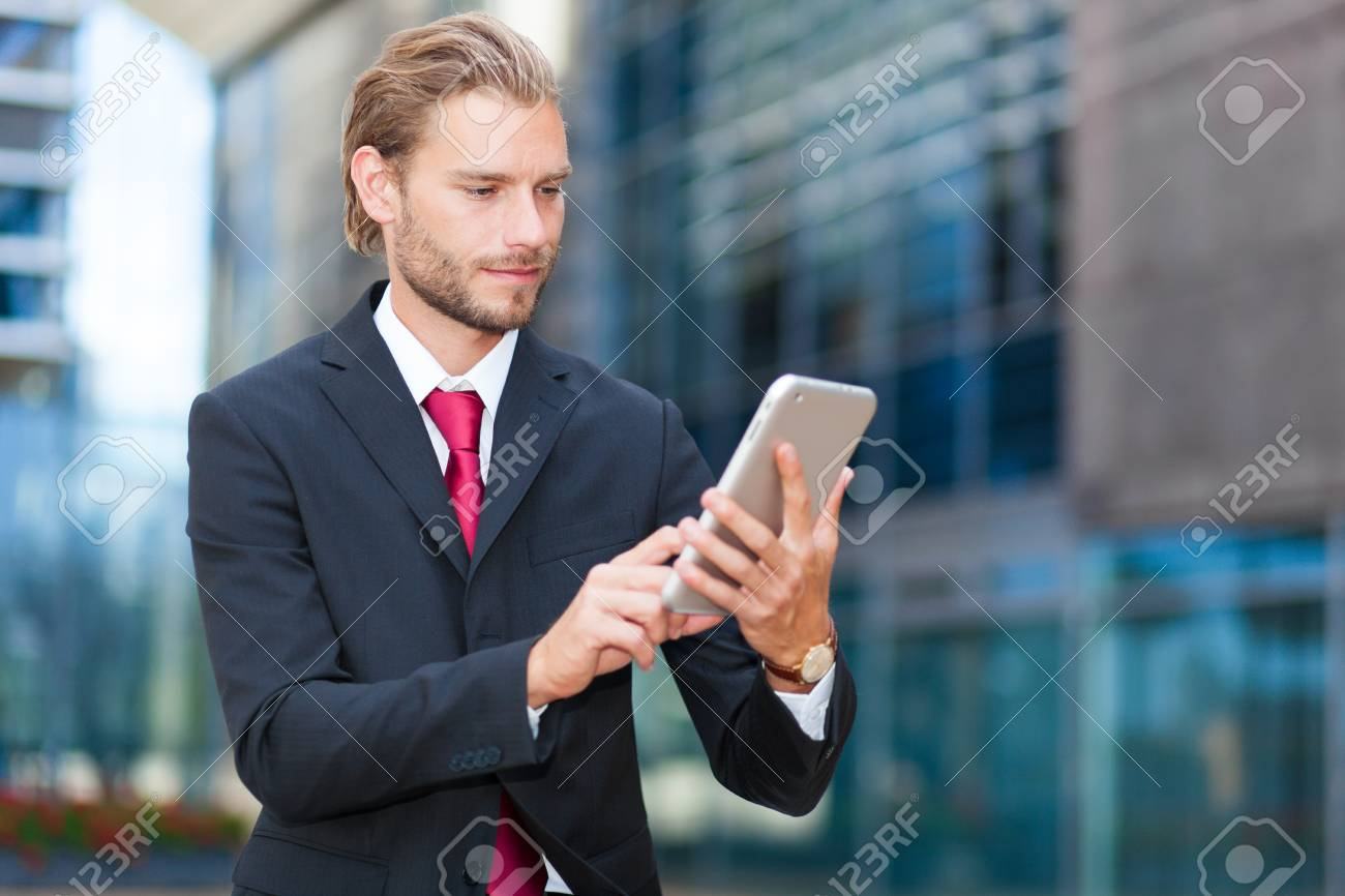 Businessman using his tablet - 55200236