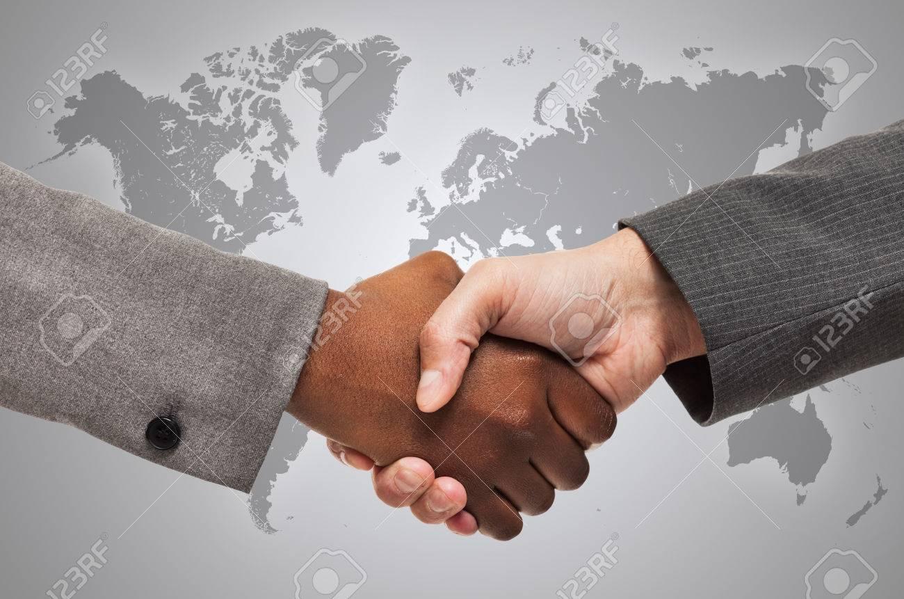 Handshake between white and black business people - 55357092
