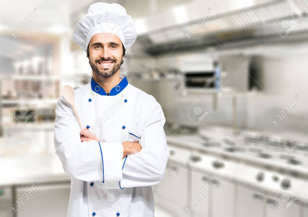 smiling chef in his kitchen stock photo picture and royalty free
