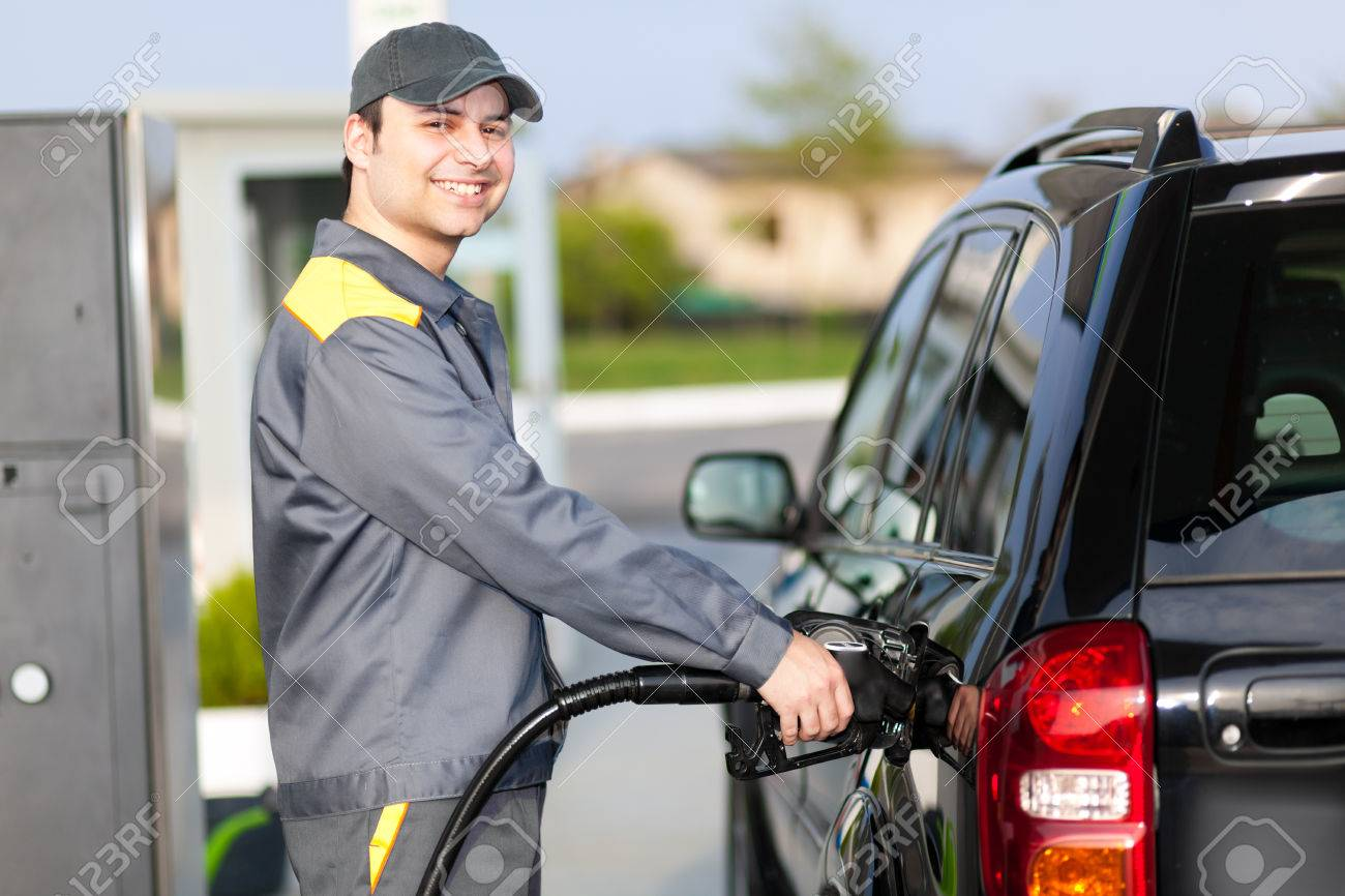 gas station attendant at work stock photo 57286938