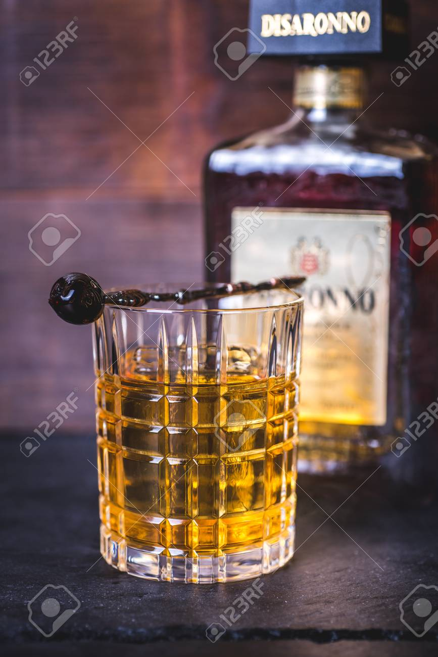 Close-up of a glass with a drink on a bottle background. - 92865841