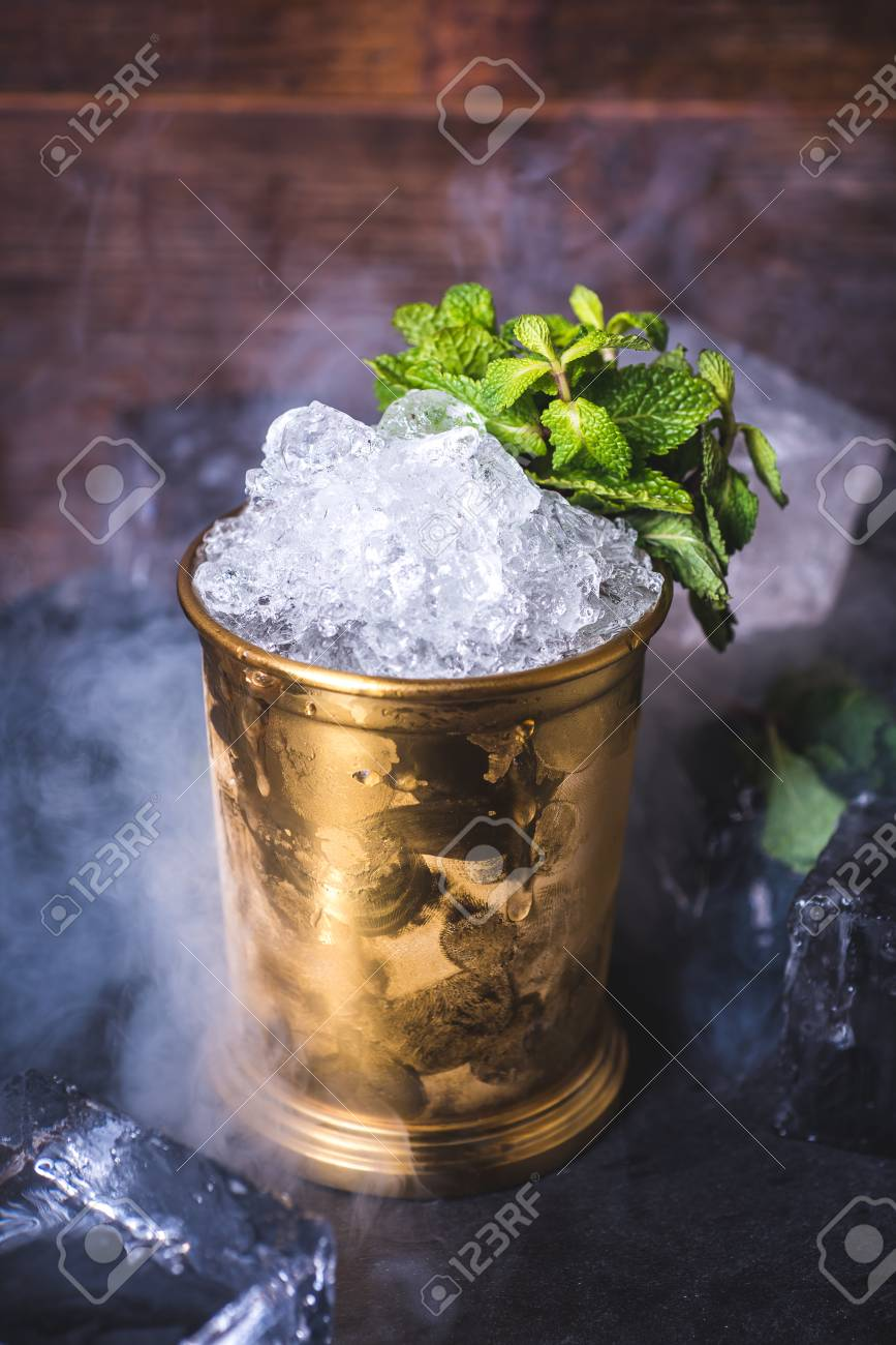 Crushed ice in a tin can on the table. - 92863988