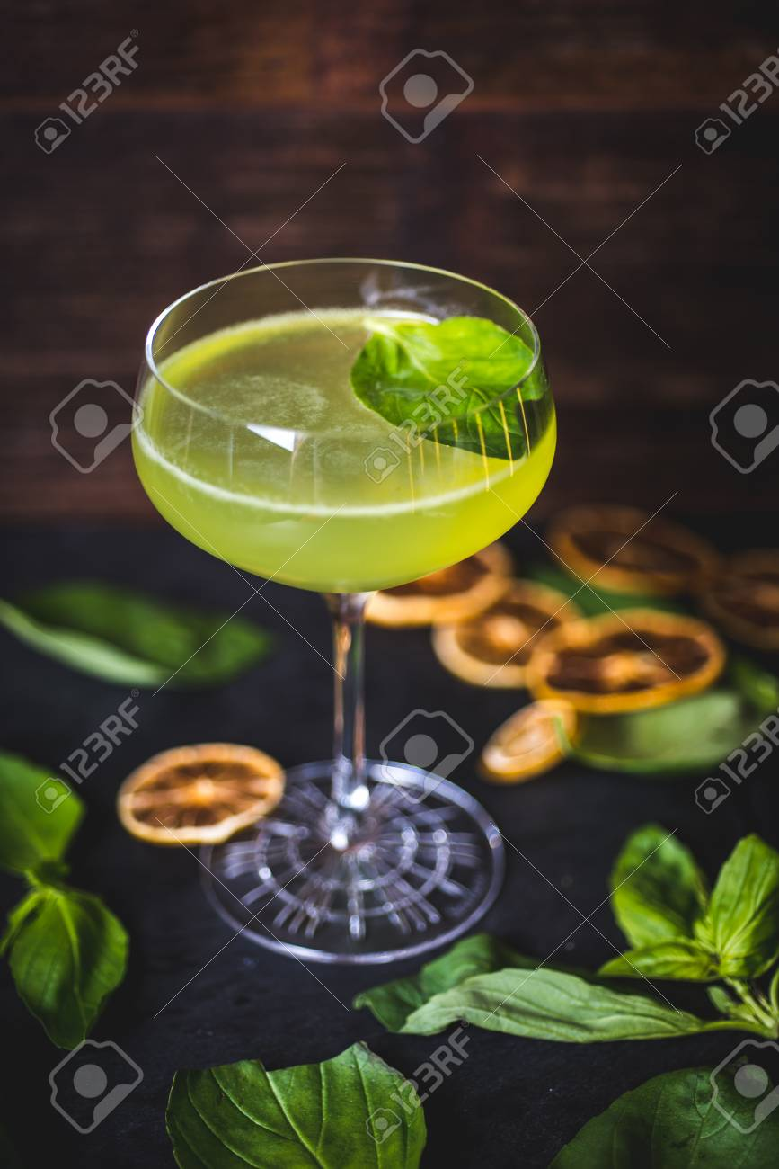 Top view of a floating mint leaf in a cocktail. - 99534760