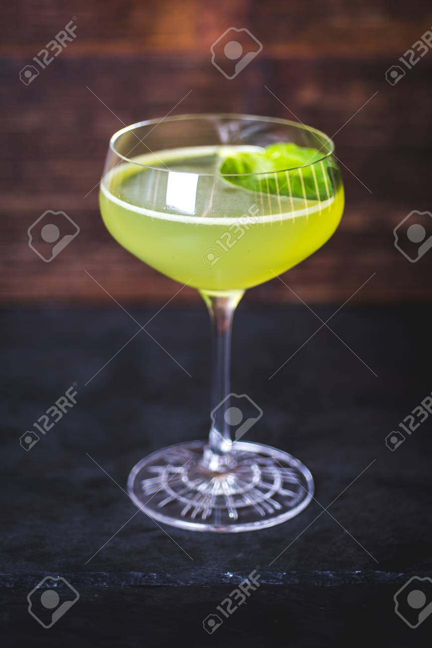 A view of the cocktail in a wine-glass on the table. - 99535116