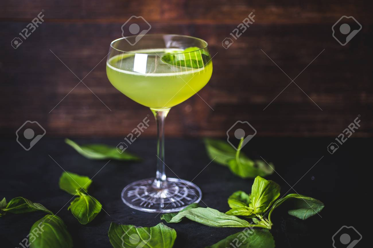 Fouger stands on a table among the lying leaves of mint. - 99535128
