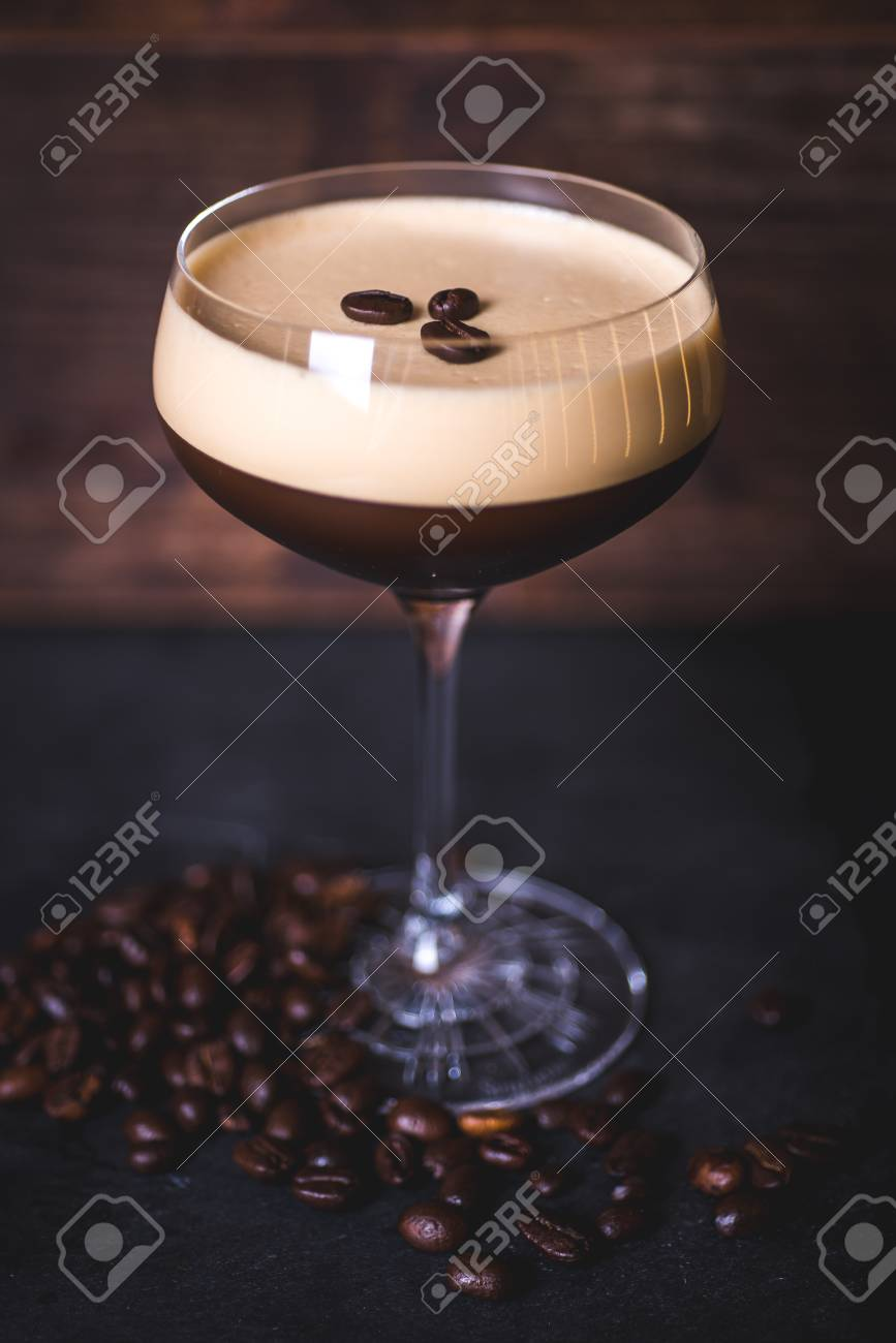 Coffee beans lie on the foam of the coffee cocktail. - 99535731