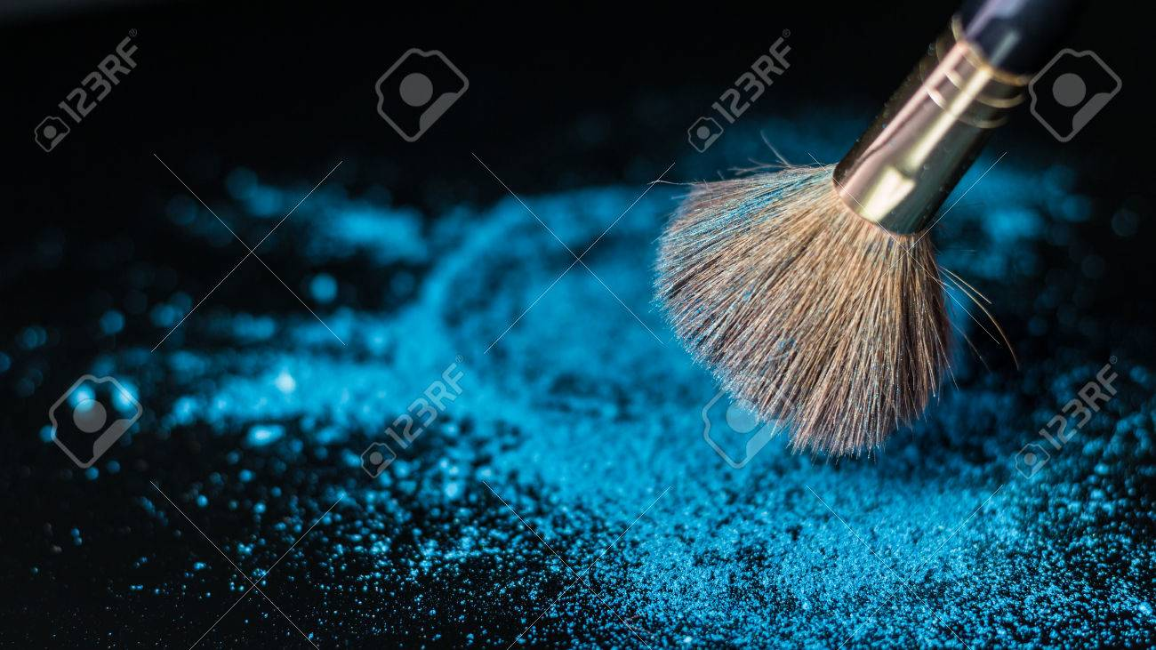 Makeup Brush On Professional Cosmetic Background With Colorful Powder Stock Photo