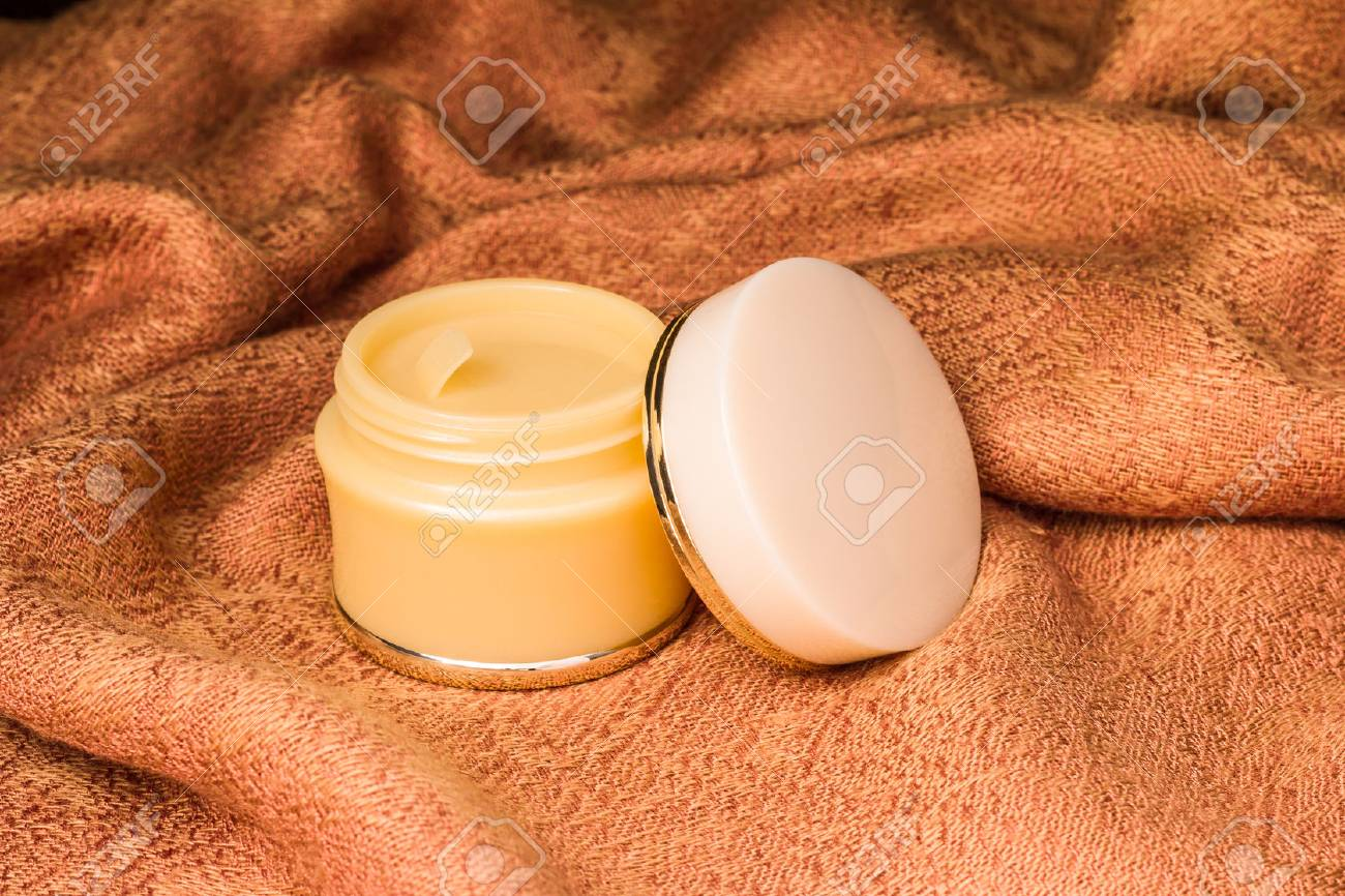 Cosmetics containers - Open blank cap white color cosmetic, Moisturizer containers for various makeup products on light brown cloth background, ready for your design product. - 72109229