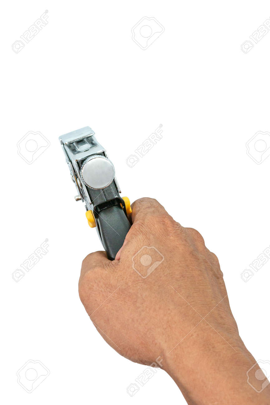 A male hand holds a construction stapler on a white background. Heavy-duty steel staple gun to repairs or DIY around your home. Selective focus. - 163135787