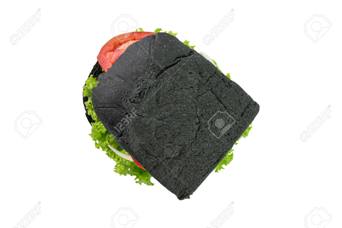 Homemade black bread sandwiches on a wooden kitchen board isolated on white background. Top view. - 166001305