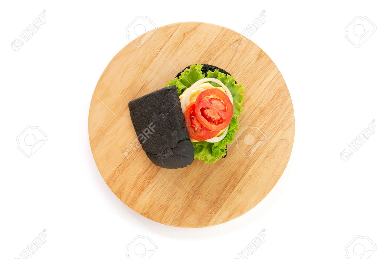 Homemade black bread sandwiches on a wooden kitchen board isolated on white background. Top view. - 166001308