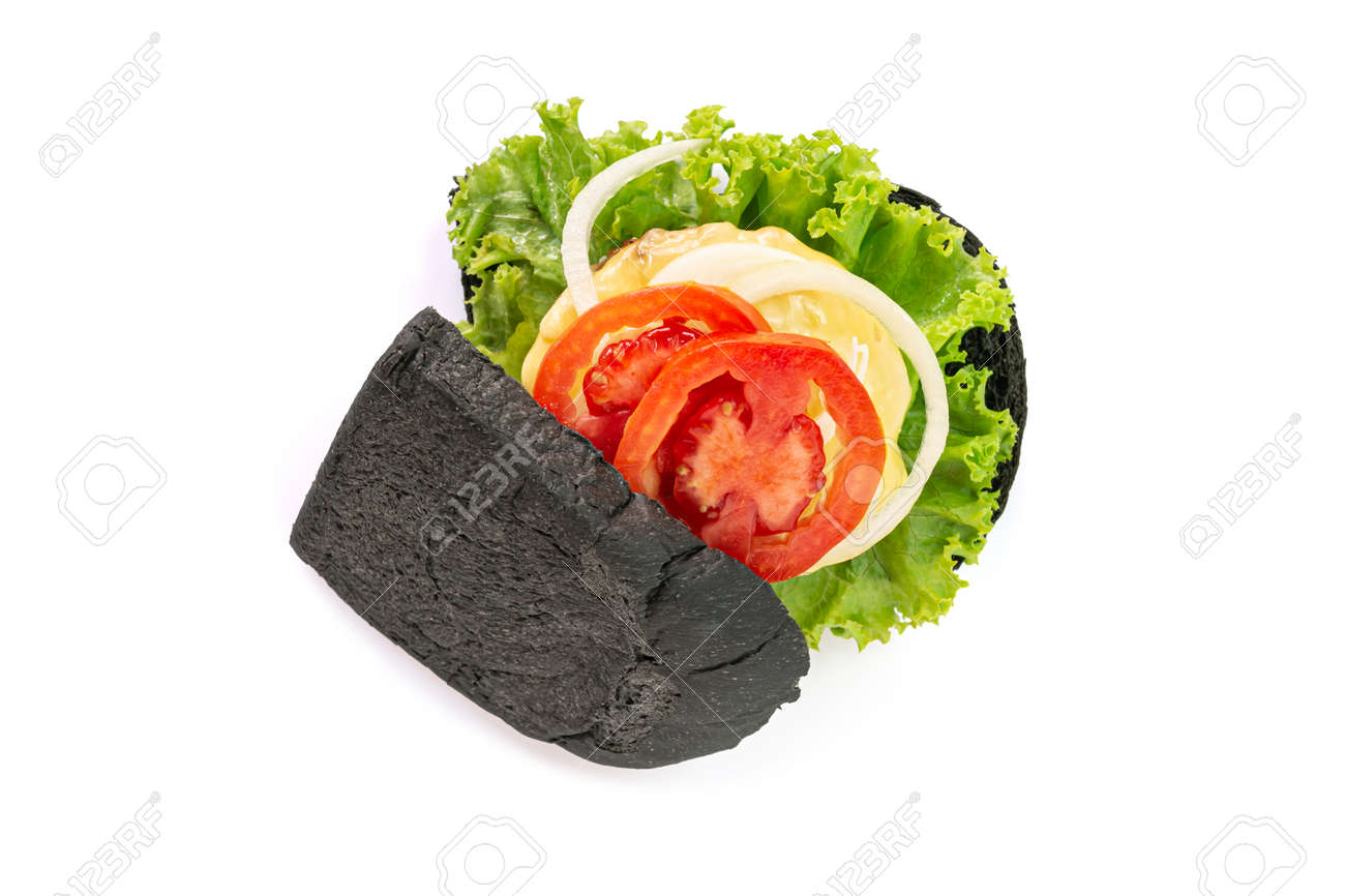 Homemade black bread sandwiches on a wooden kitchen board isolated on white background. Top view. - 166001321