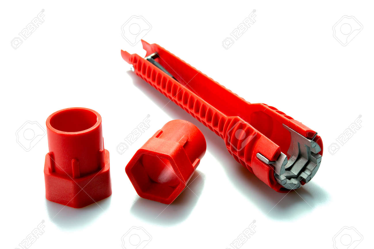 Red pipe wrench isolated on white background. Selective focus. - 166001347
