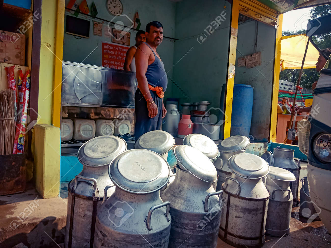 DISTRICT KATNI, INDIA - OCTOBER 06, 2019: Milk container kept at milk shop on road side. - 155895642