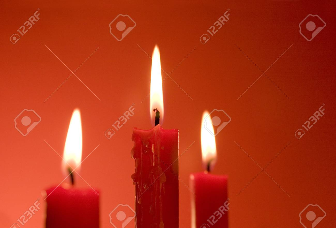 Three candles against a red background. Stock Photo - 3420161