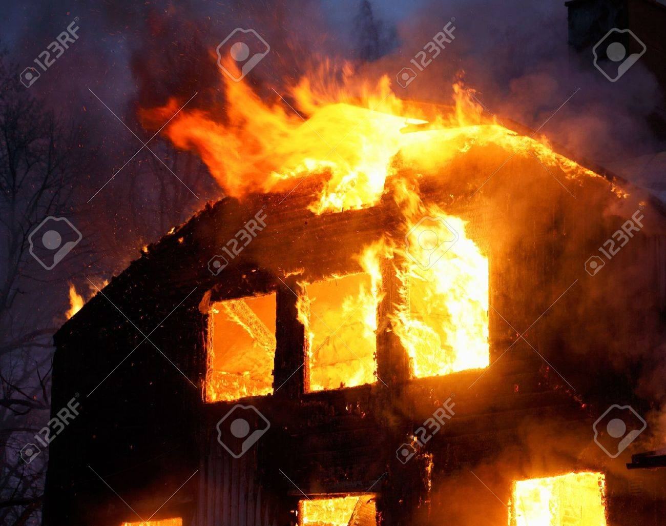 Wooden house buring. Stock Photo - 3422862