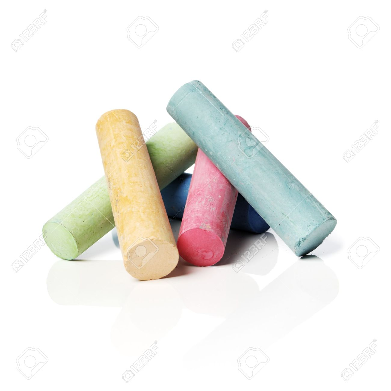 Colored sidewalk chalks on reflective background with natural shadows. Stock Photo - 7492011