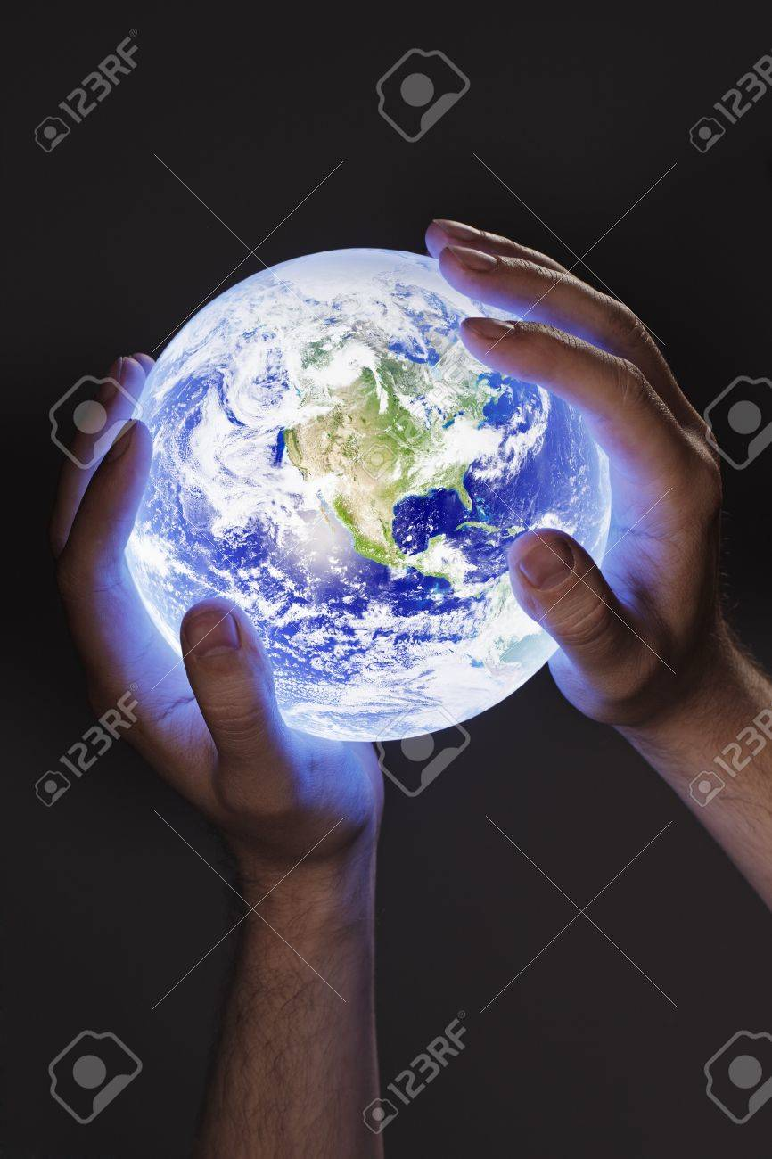 Man holding a glowing earth globe in his hands. Earth image provided by Nasa. Stock Photo - 7917302