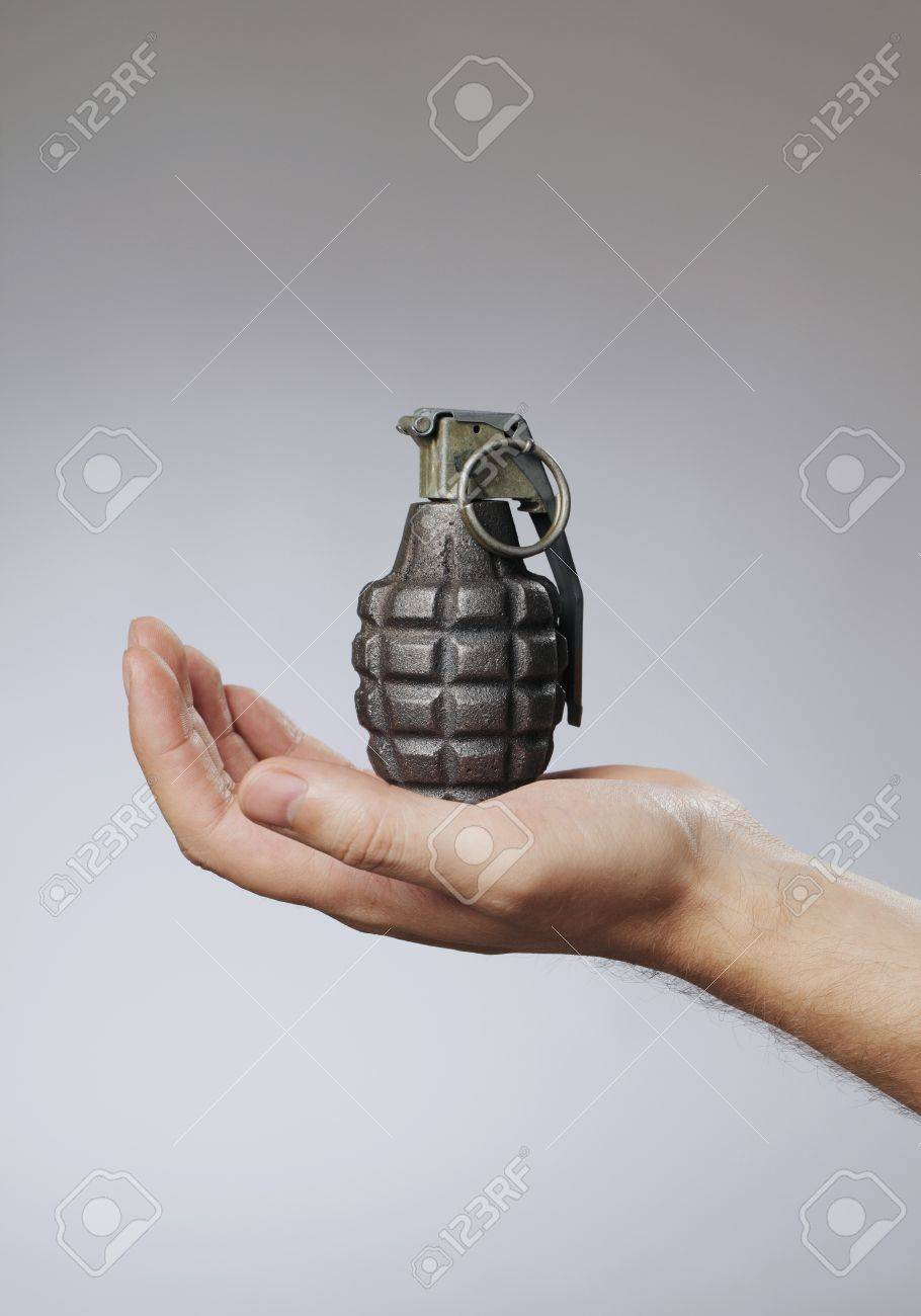 Man holding a hand grenade in his hand Stock Photo - 7917310
