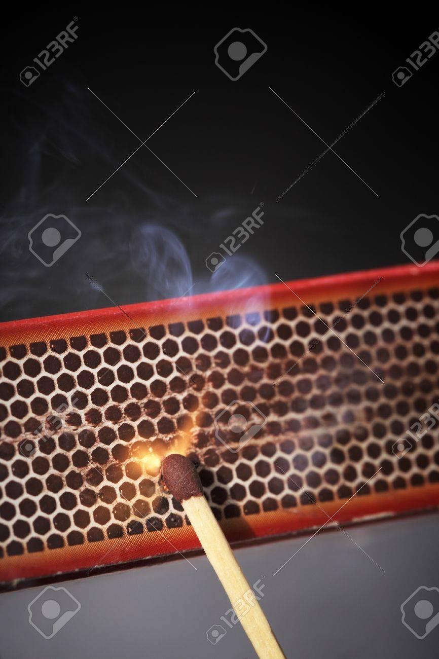 Striking a match against a match box. Stock Photo - 11813485