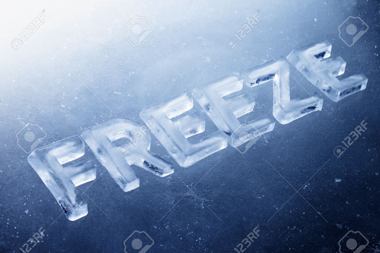 word freeze made of real ice letters on ice background stock