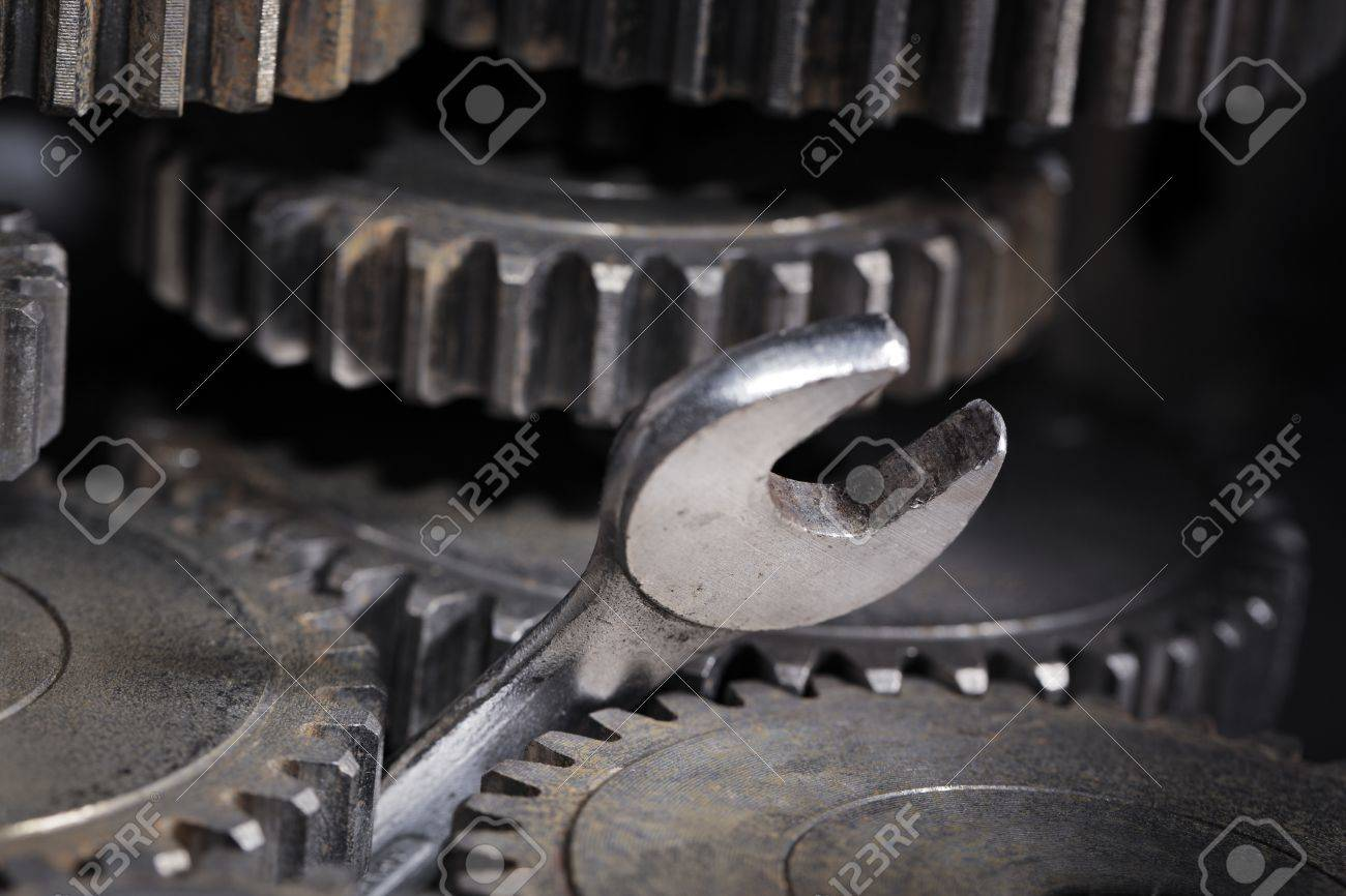 A Spanner Wrench Stuck Between Cog Gear Wheels Stock Photo Picture