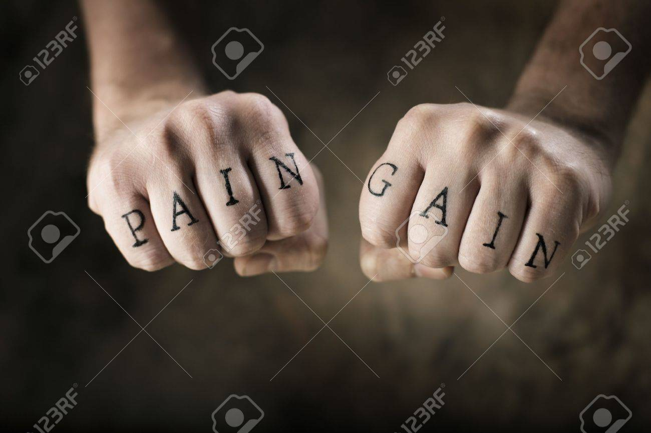 Man With Fake Tattoos Pain And Gain On His Hands Referring