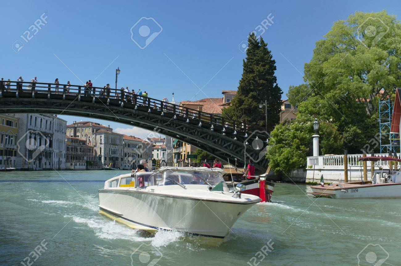 Venice, Veneto, Italy - May 24: Taxi boat driving under Ponte dell'Accademia bridge on Grand Canal. circa May 24, 2011 in Venice, Veneto, Italy Stock Photo - 14146144