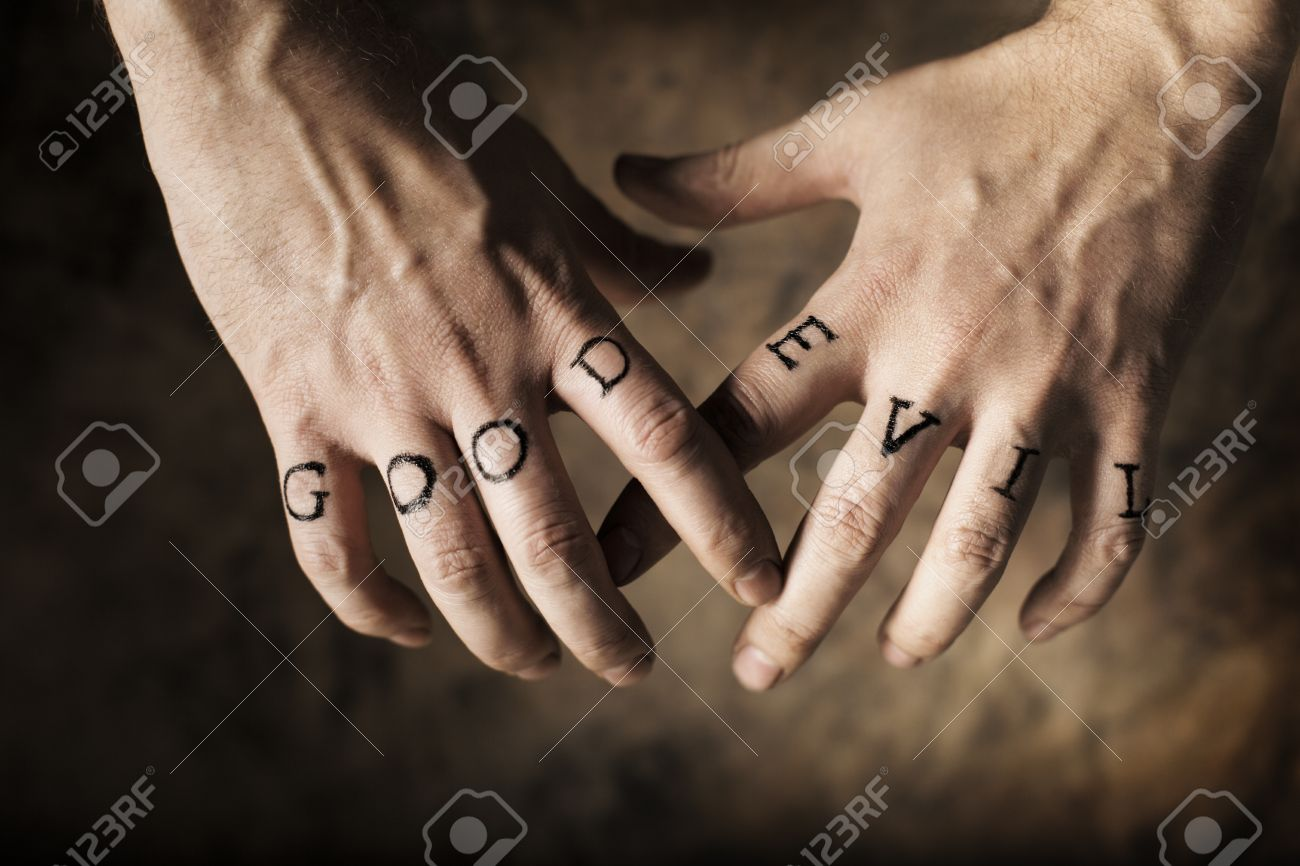 Man With Good And Evil Fake Tattoos On His Hands