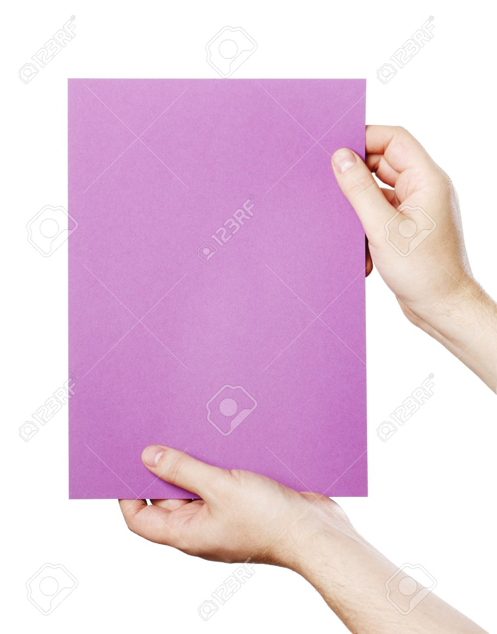 Man holding a blank purple paper against white background. Stock Photo - 18724957
