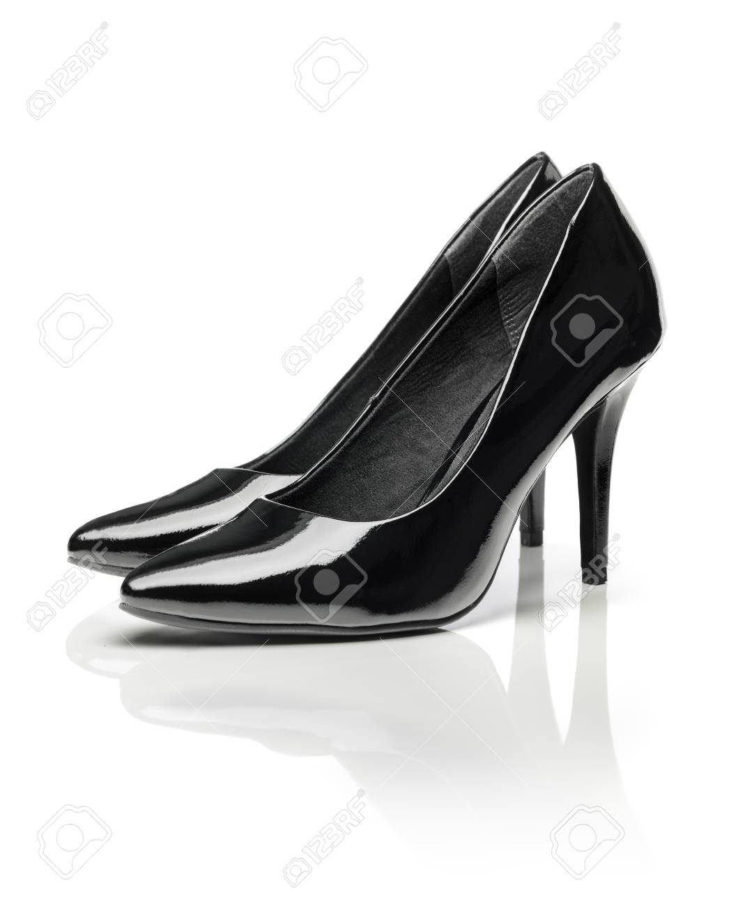 164e3646df Black shiny patent leather stiletto heel pumps isolated on white with  natural reflection. Stock Photo