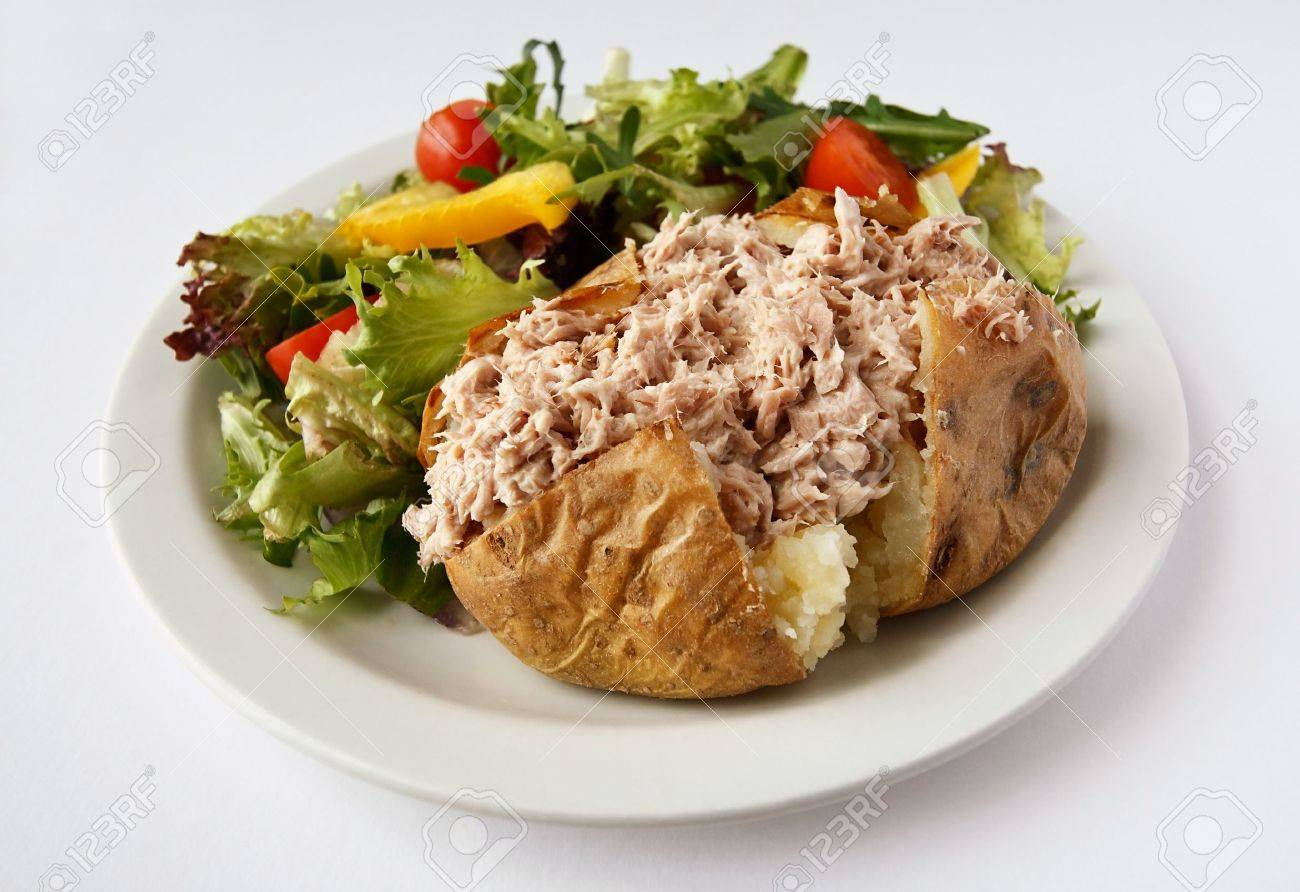 Tuna mayonnaise baked potato on a plate with side salad Stock Photo - 12681976