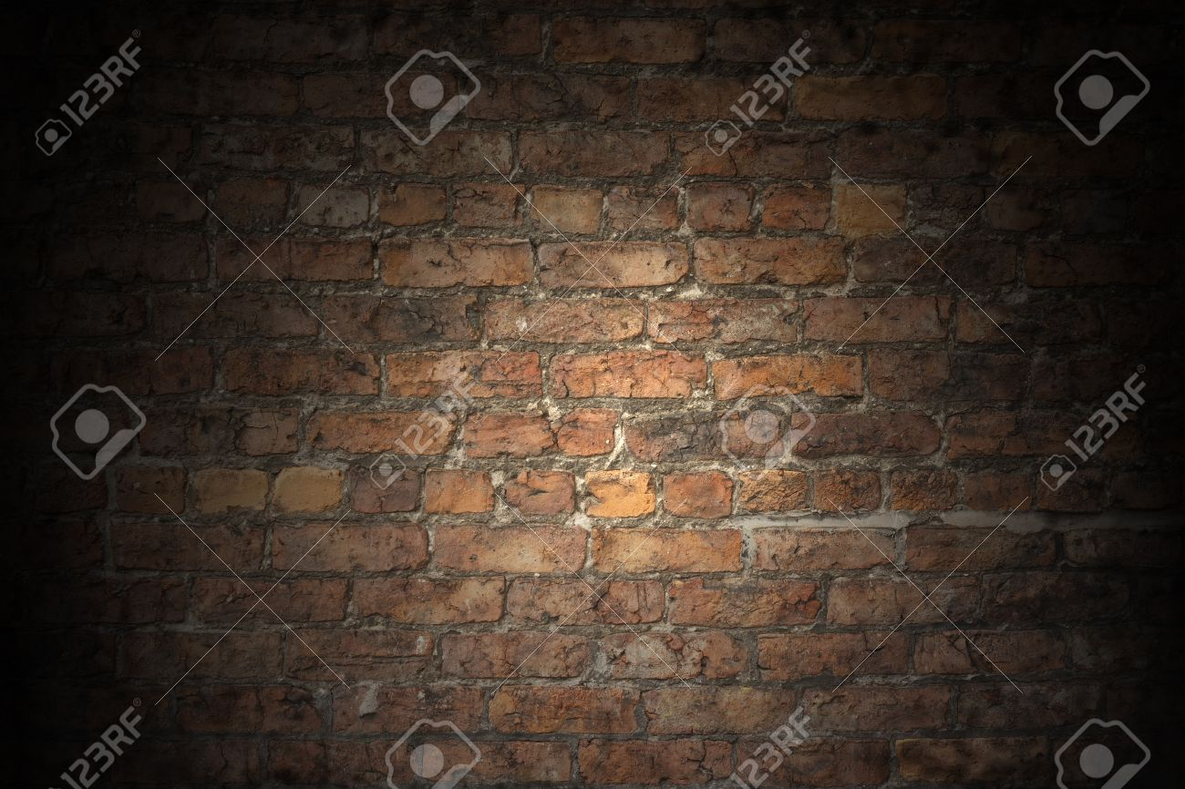 a plain red brick wall old and worn with grey aged grouting stock