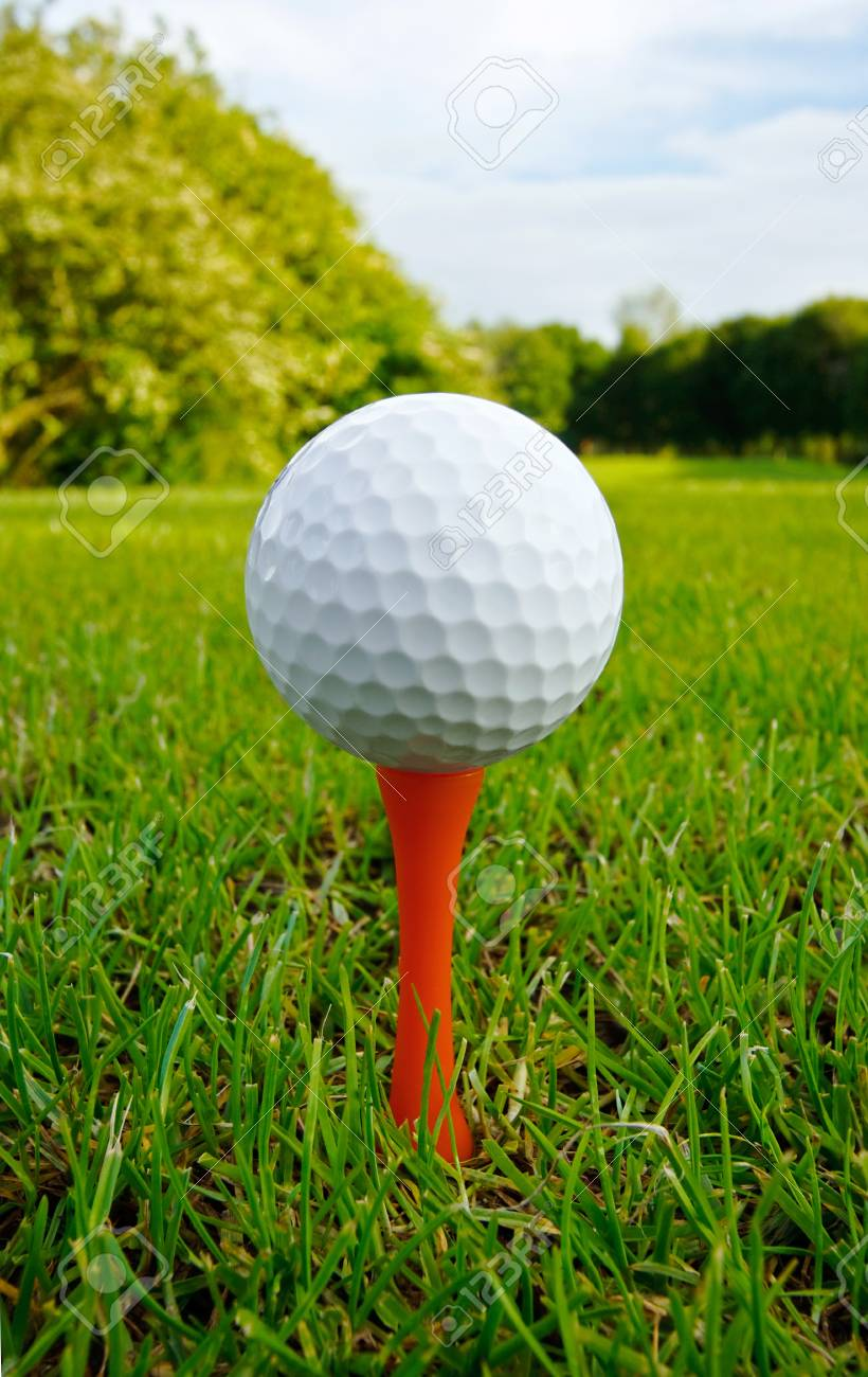 Golf Ball On Tee Close Up With Fairway And Flag In Distance Stock Photo Picture And Royalty Free Image Image 14445022
