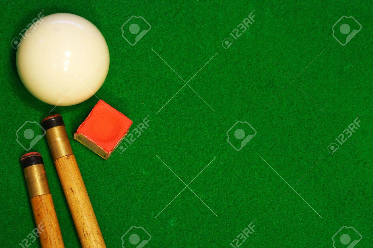 A Green Cloth Billiards Or Pool Table Background With Cues, Cueball And  Chalk Stock Photo