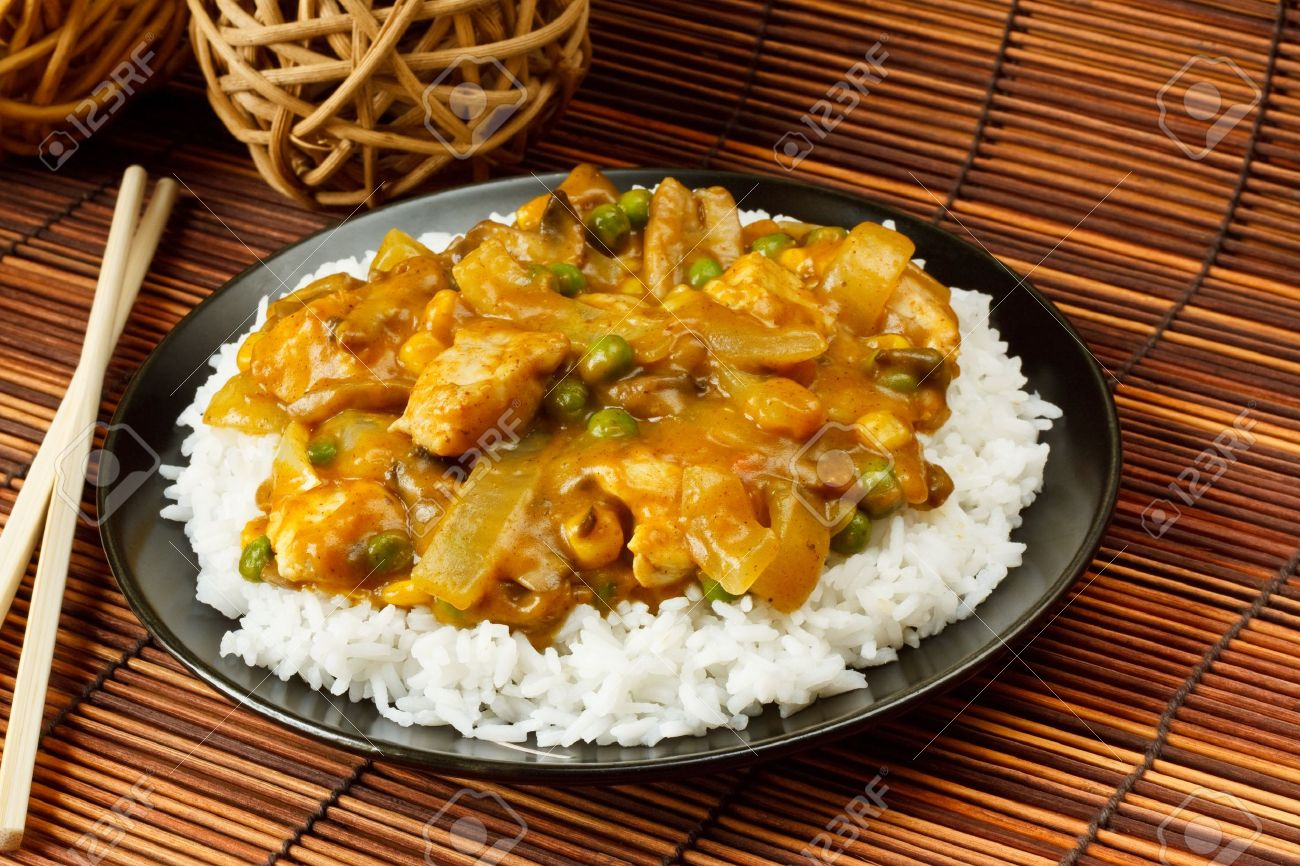 Chicken curry with boiled rice a popular chinese food available chicken curry with boiled rice a popular chinese food available at take aways stock photo ccuart Images